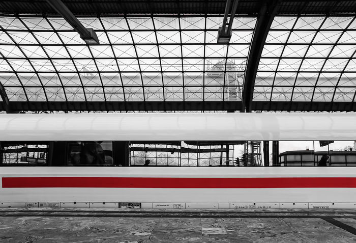 the red line .... Architectural Feature Architecture Art Bahnhof Bahnsteig  Built Structure Business Design Designs Full Frame Glass - Material Indoors  Keycolor No People One Color Public Transportation Red Reflection Rot Skylight Station Train Transportation Zug Krull&Krull Images Colorkey Business Stories Mobility In Mega Cities