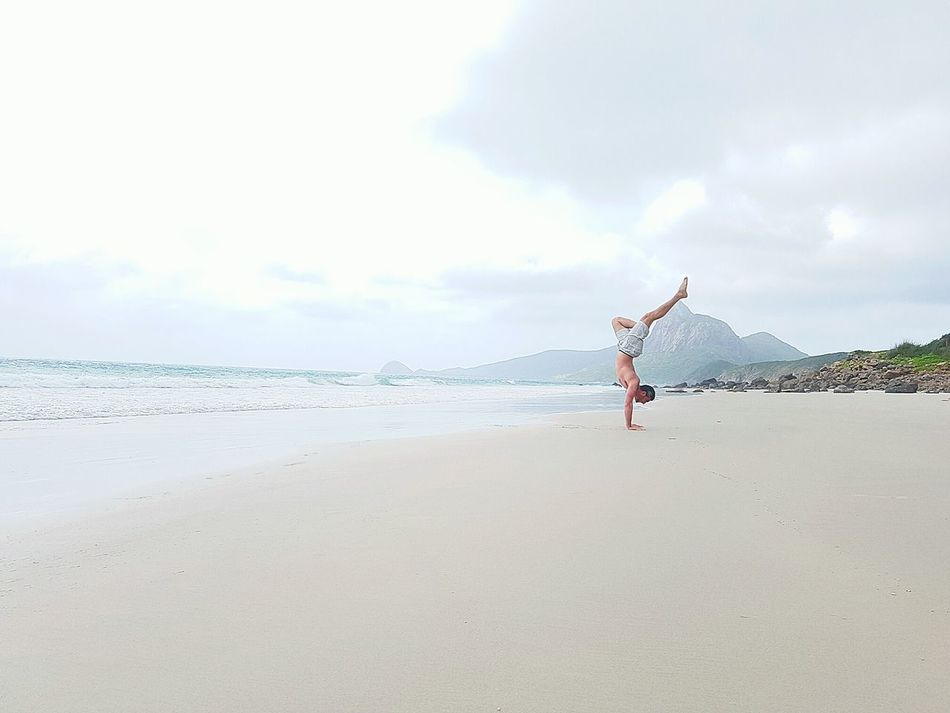 Handstand on the Beach Cloud - Sky Beach Sky Vacations Outdoors One Person Sand Nature Sea Day Water People Handstand  Gym Fitness