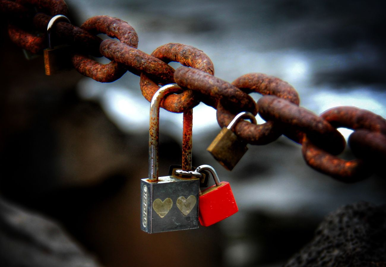 Lanzarote Spain Padlock Metal Chain Love Lock Close-up Hanging Rusty Love Hope Focus On Foreground Rock - Object Travel Destinations Journey