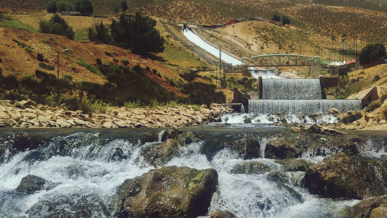 water, dam, waterfall, flowing water, motion, hydroelectric power, long exposure, nature, day, non-urban scene, beauty in nature, scenics, mountain, no people, outdoors, river, fuel and power generation, built structure, tree, architecture