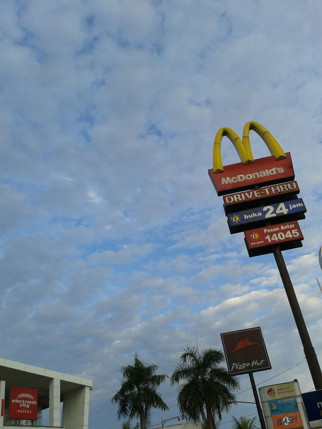 Westernization. Franchise Fast Food Blue Sky Clouds And Sky