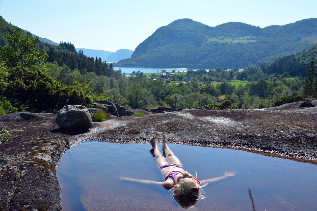 Beauty In Nature Calm Capture The Moment Floating On Water Little Girl Landscape Meditation Mindfulness Mountain Natural Pool Norway Nature Outdoors Relaxing Relaxing Moments Scenics Summer Sunbathing Tranquility Tranquil Scene Time To Reflect Water Waterfall Waterfall Trip in Norway