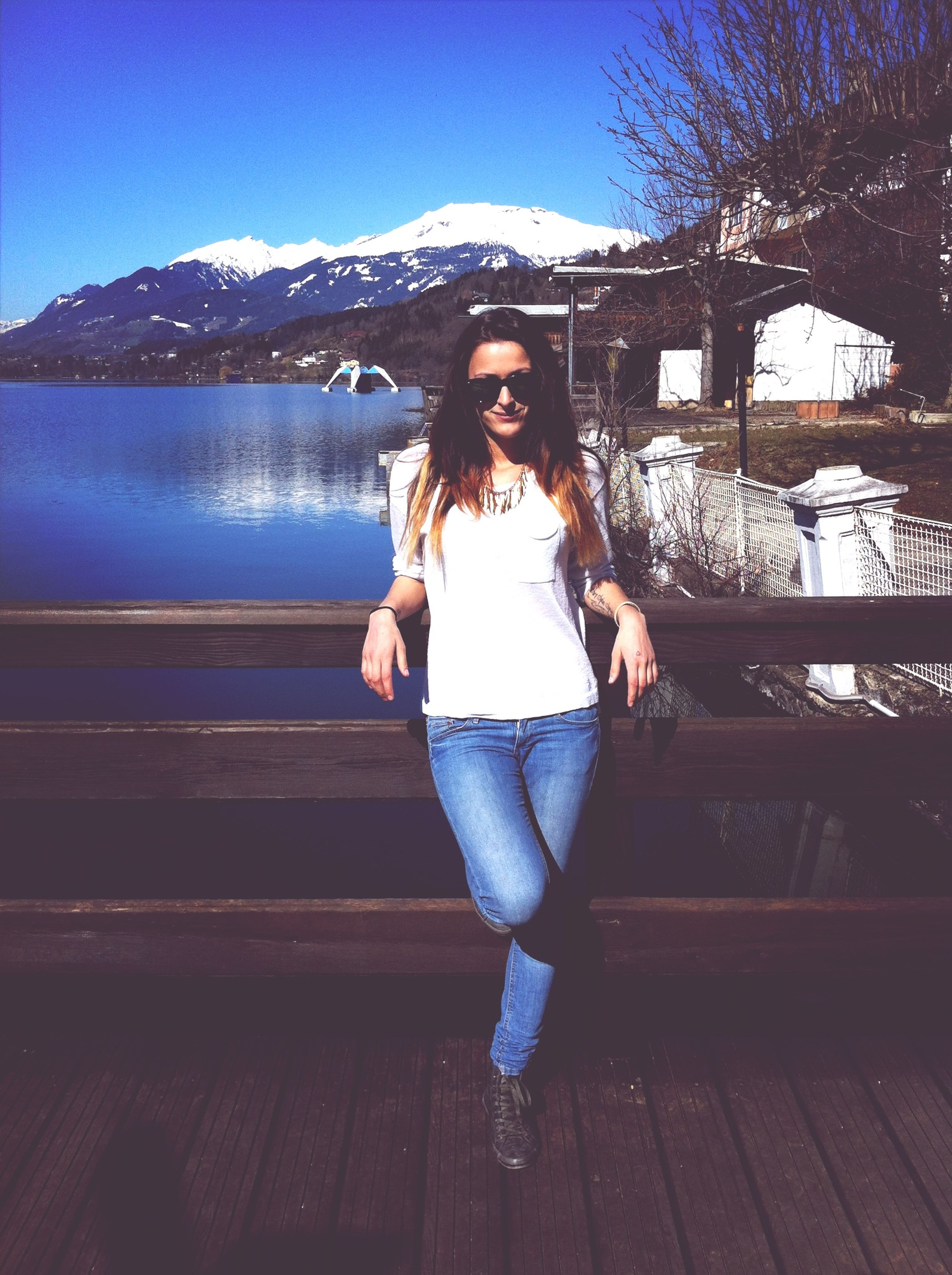 young adult, person, lifestyles, leisure activity, full length, young women, casual clothing, water, looking at camera, portrait, front view, smiling, standing, sunglasses, happiness, vacations, sunlight, mountain