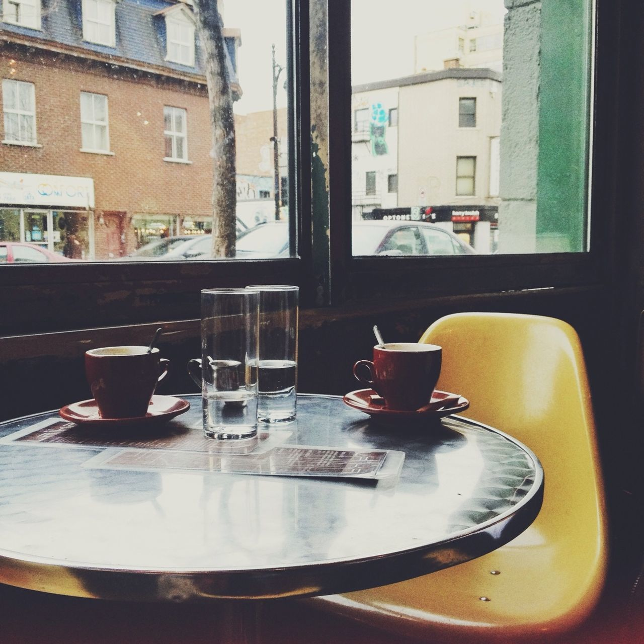Glasses And Coffee Cups On Table In Restaurant