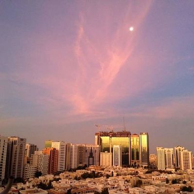Abu Dhabi Sky And Clouds UAE Architecture Building Exterior Built Structure City Cityscape Downtown District Illuminated Modern No People Outdoors Sky Skyscraper Sunrise Sunrise_sunsets_aroundworld Sunset Urban Skyline