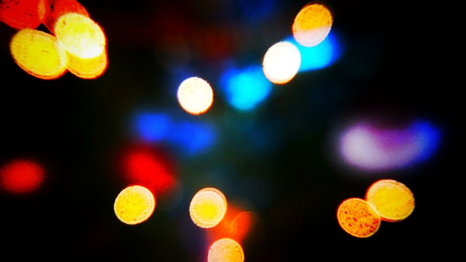 Defocused Illuminated Night Multi Colored No People Close-up Christmas Decoration Outdoors Nightlife Light Effect Nature Black Background Lights Decorative Bokeh Bokeh Photography Abstract Xmas Decorations Xmas Lights  Xmas Lights  Lighting Equipment Indoors  Spotted Vibrant Color