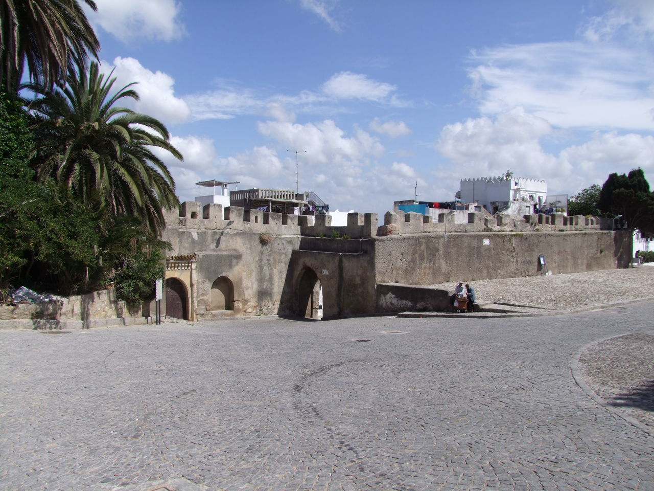 Kasbah Walls Blue Sky White Clouds Building Exterior Built Structure Castle Walls City Composition Full Frame Historical Monument Historical Place History Incidental People Kasbah Moroccan Architecture Moroccan Style Morocco Old City Open Space Outdoor Photography Palm Trees Sunlight And Shadow Tangier Tourist Attraction  Tourist Destination Tree Walls