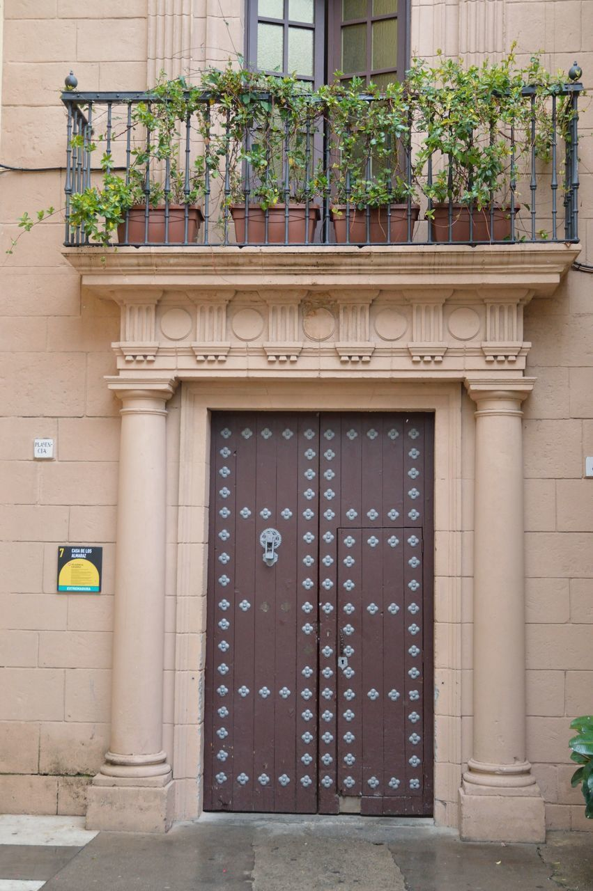 building exterior, architecture, built structure, door, outdoors, day, entrance, no people, plant, entry