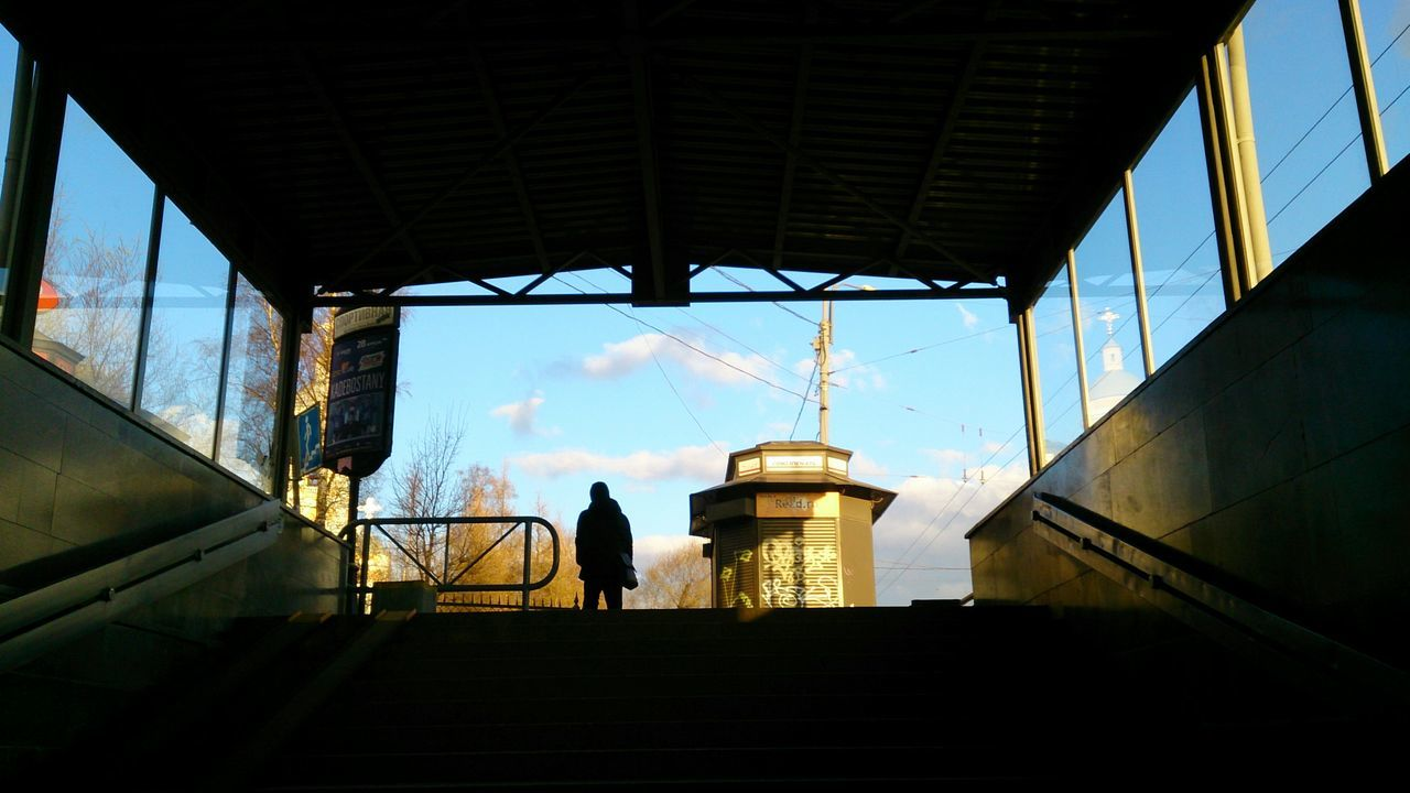 Low Angle View Of Silhouette People Seen Through Subway Station