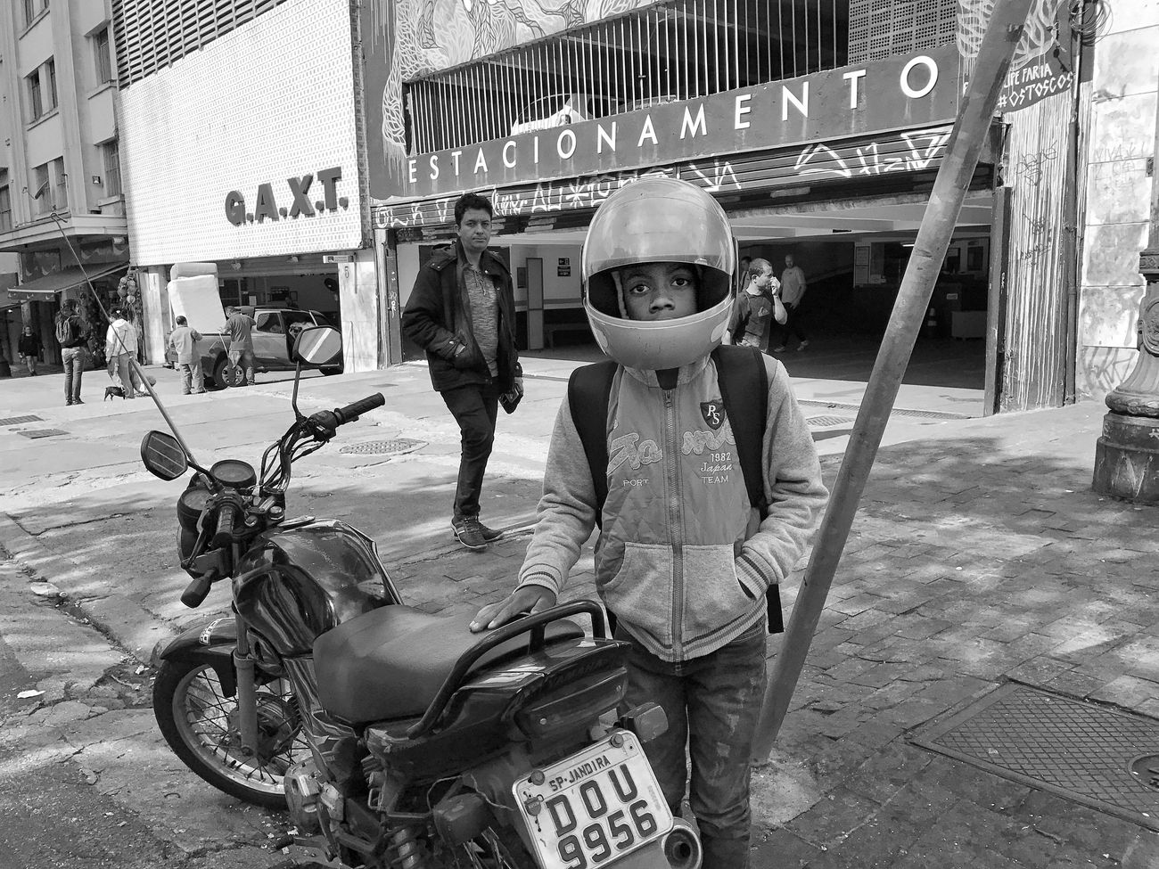 """""""Space Oddity"""". July, 2017 Streetphotography Motorcycle Transportation Full Length Land Vehicle Day Helmet Headwear Childhood Outdoors One Person People Adult Adults Only"""