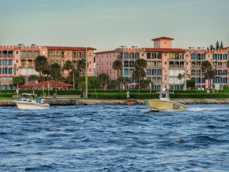 Architecture Waterfront Residential Structure Water Palm Tree In Front Of Boats Motion Choppy Waters Travel Destinations Morning Florida Waterway