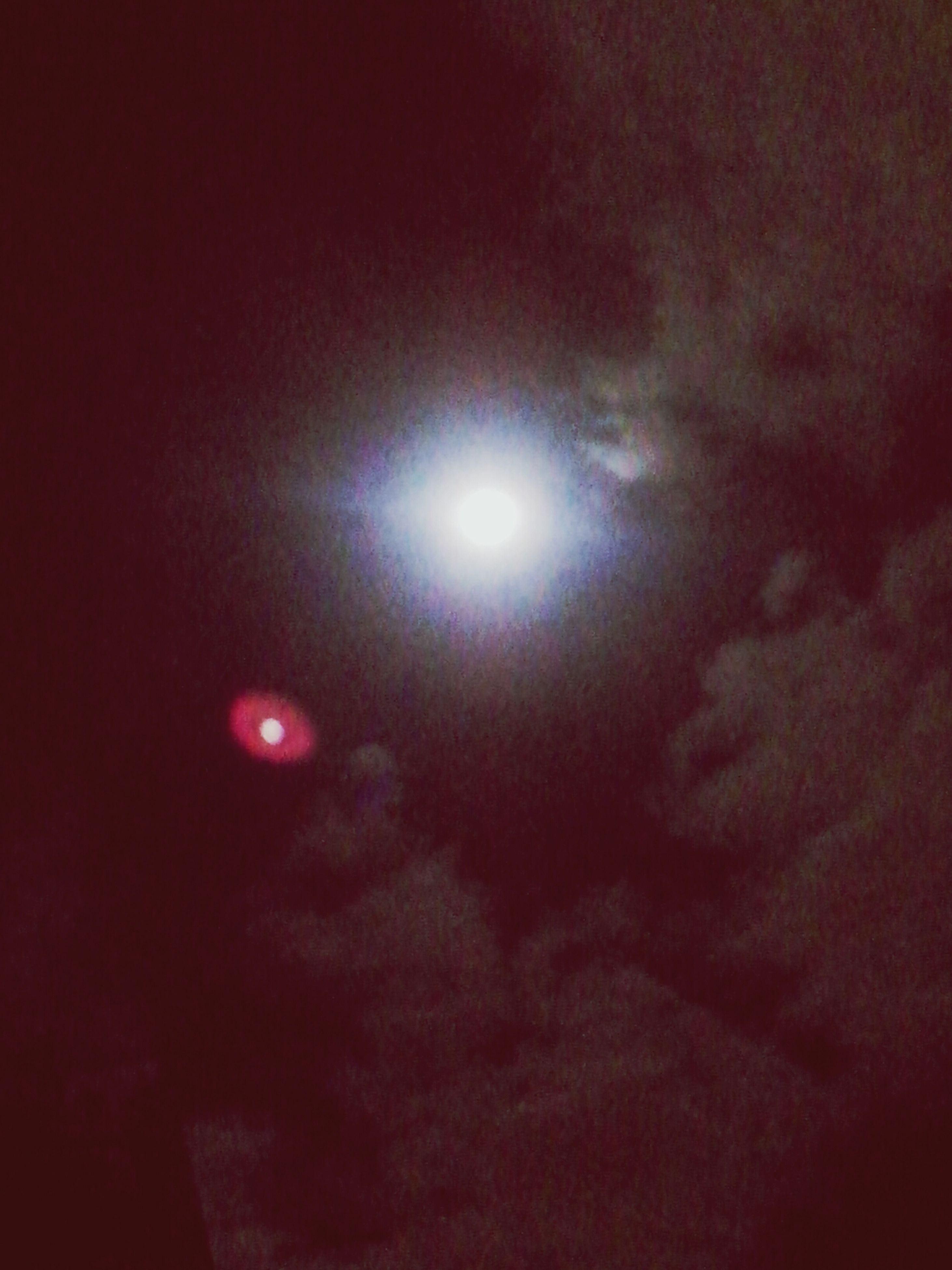 low angle view, sky, night, illuminated, moon, red, sun, lighting equipment, weather, beauty in nature, nature, glowing, cloud - sky, sky only, scenics, no people, light - natural phenomenon, lens flare, dark, tranquility