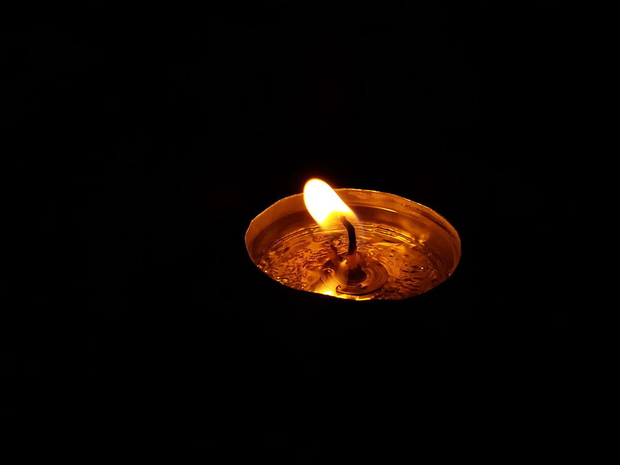 Black Background Burning Candle Flame Candle Light Close-up Cultures Diwali Diya - Oil Lamp Flame Glowing Heat - Temperature Illuminated Indoors  Kali Puja Lighting Equipment No People Oil Lamp