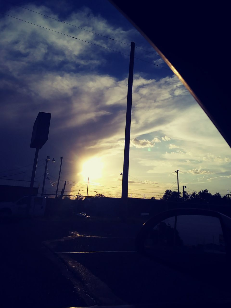 sunset, sky, cloud - sky, car, transportation, silhouette, no people, land vehicle, sun, road, outdoors, nature, day