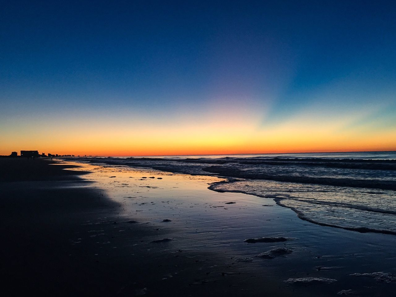 Sea Beauty In Nature Water Nature Tranquil Scene Scenics Sunset Reflection Beach Tranquility Horizon Over Water Sky Idyllic Outdoors No People Sand Day Sunrise Ocean