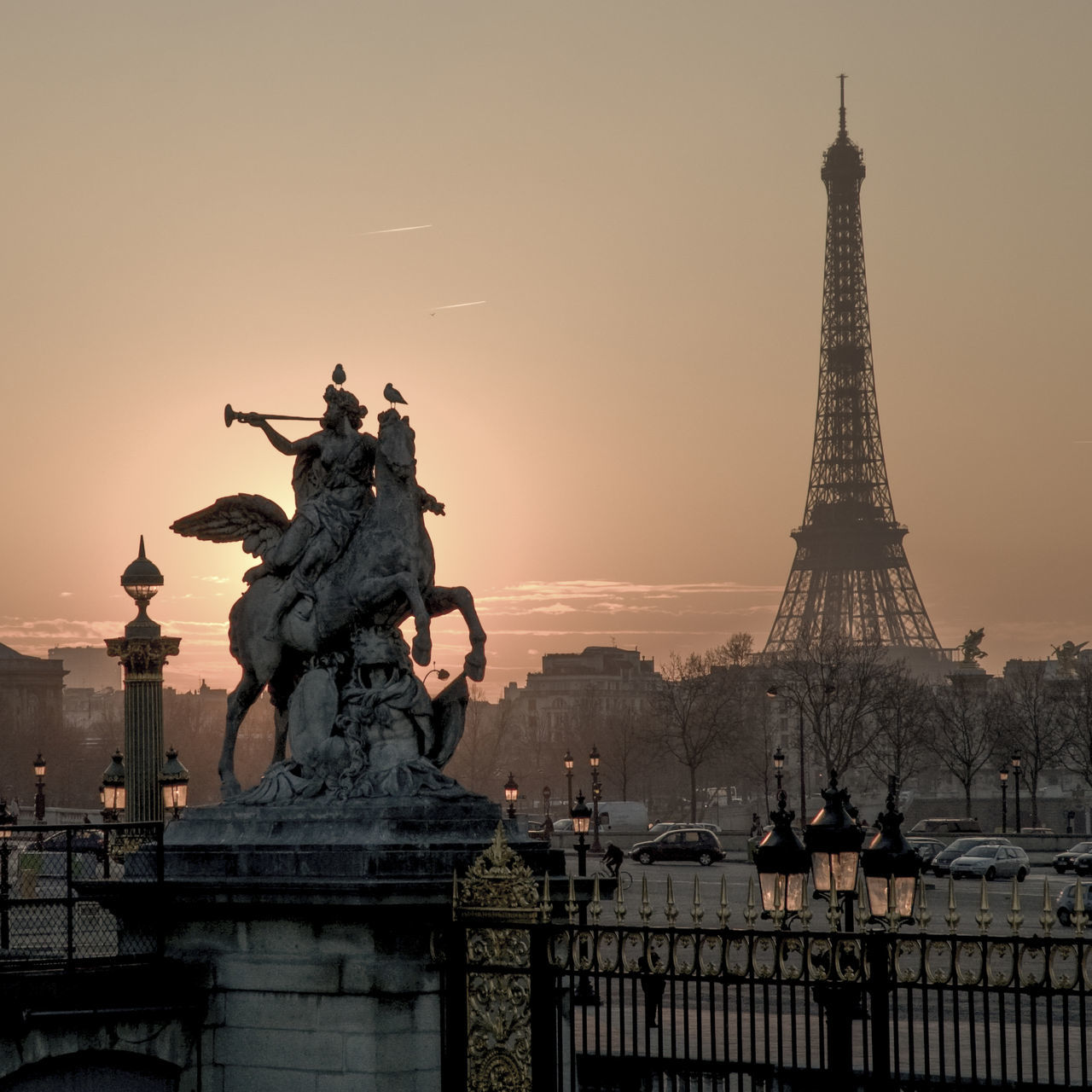 Paris, Eiffel Tower, sunset behind a statue, Tuileries garden. Eiffel Tower Famous Place International Landmark Light Monument Paris Sculpture Spirituality Statue Statue Sunset Tour Eiffel Travel Pastel Colors Travel Destinations Panorama Capital Cities