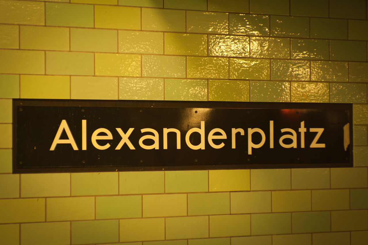 Alexanderplatz Architecture Capital Letter Close-up Communication Day Guidance Illuminated Indoors  No People Station Text Tile Tube Underground Western Script Yellow