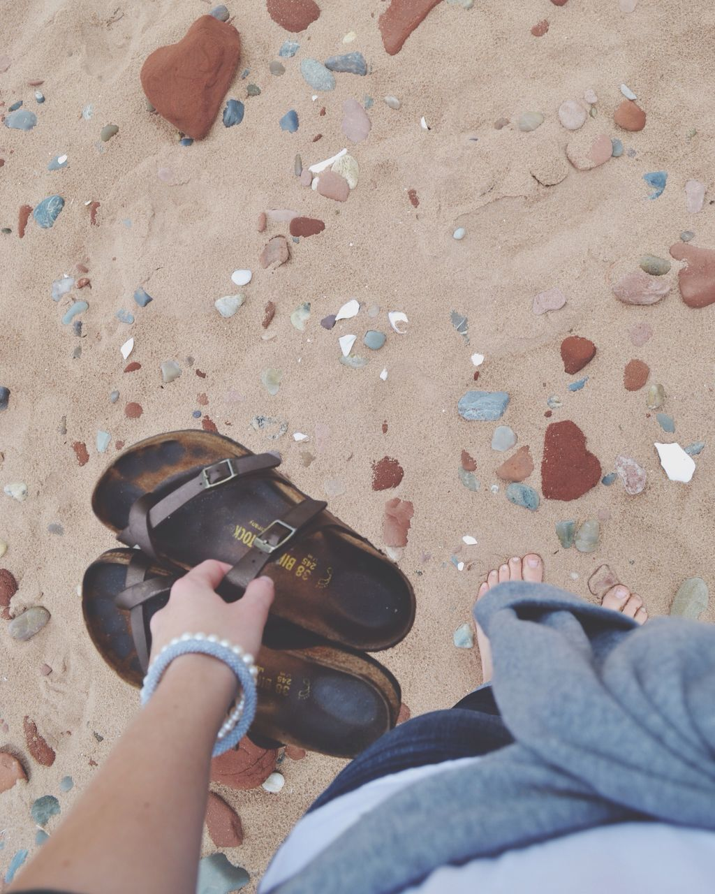 real people, human body part, one person, human hand, personal perspective, lifestyles, human leg, holding, men, high angle view, leisure activity, low section, sand, day, women, beach, outdoors, close-up, people, adult