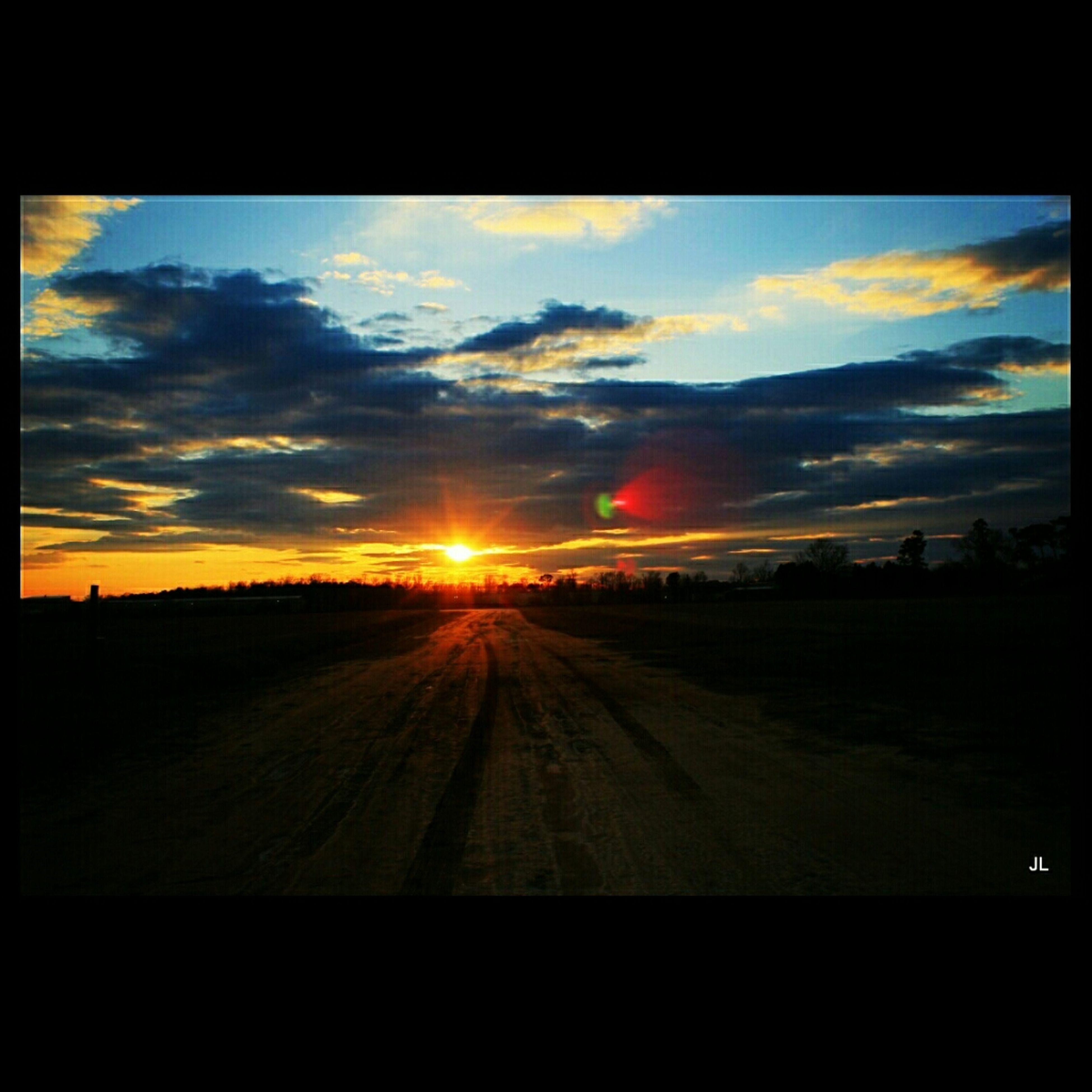 sunset, sky, cloud - sky, transportation, transfer print, sun, landscape, orange color, scenics, cloud, tranquil scene, silhouette, cloudy, beauty in nature, auto post production filter, dramatic sky, tranquility, road, nature, sunlight