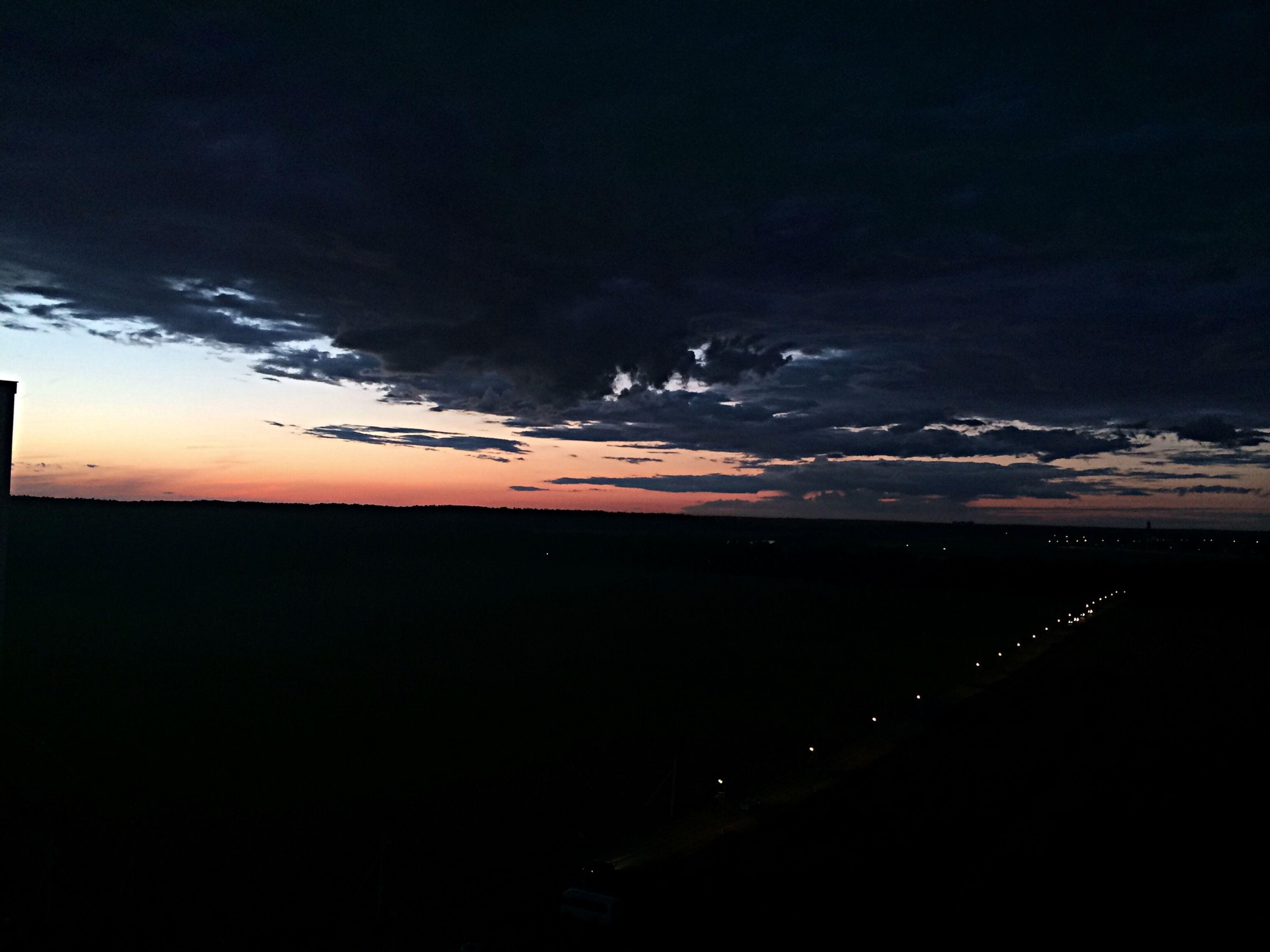 sky, scenics, sunset, tranquil scene, beauty in nature, silhouette, tranquility, sea, cloud - sky, beach, dusk, nature, idyllic, dark, horizon over water, water, cloudy, dramatic sky, night, shore