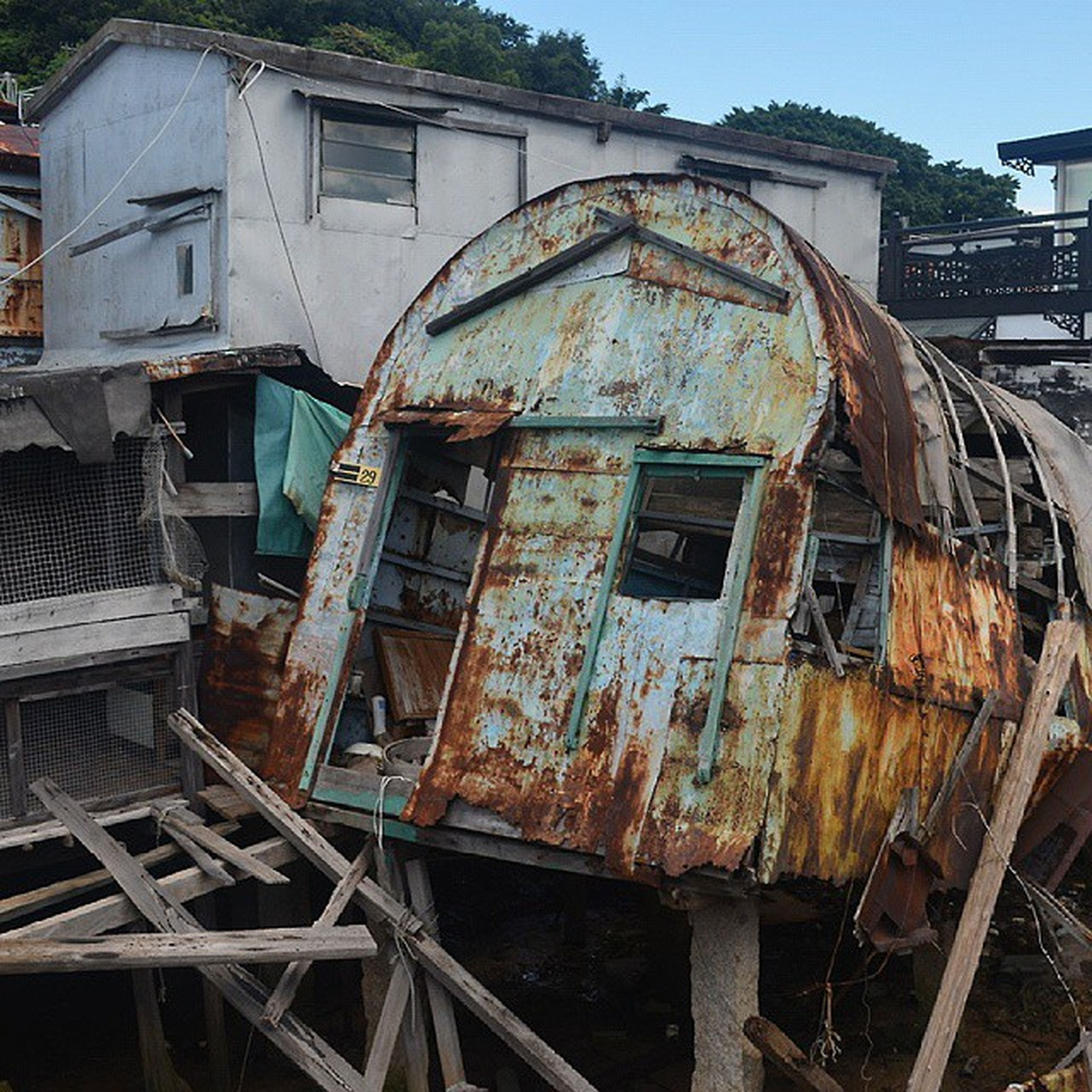 abandoned, obsolete, damaged, deterioration, run-down, old, built structure, architecture, bad condition, building exterior, weathered, rusty, ruined, destruction, factory, broken, industry, construction site, house, metal