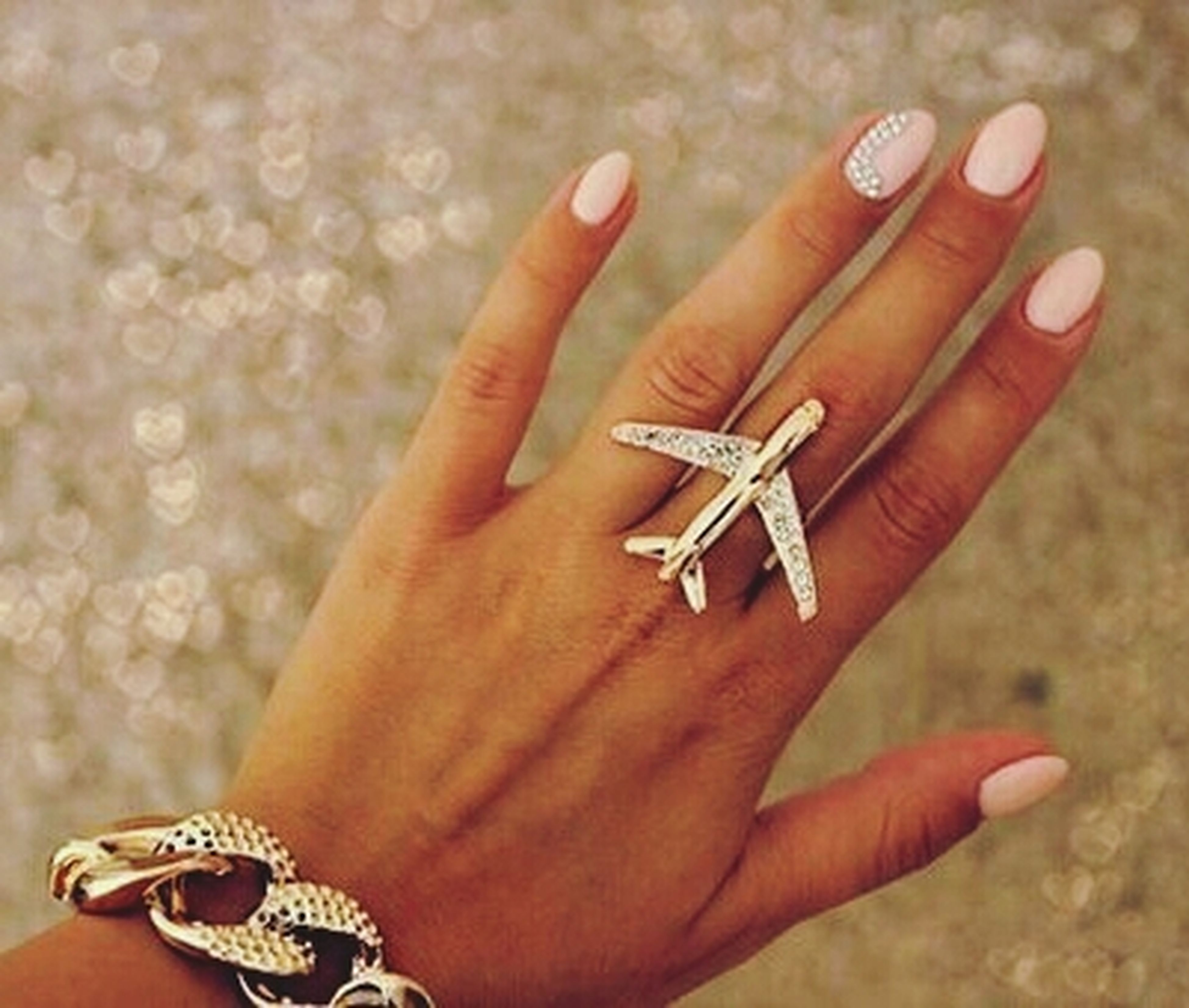 person, part of, human finger, holding, cropped, personal perspective, close-up, ring, unrecognizable person, lifestyles, focus on foreground, leisure activity, nail polish, showing, palm, bracelet