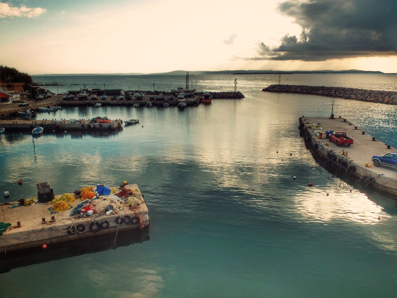 Early Morning Sunlight Cloud - Sky Landscape Beauty In Nature Fishing Port Fishing Village High Angle View Aerial View Aerial Shot Dronephotography Drone  Nature Nautical Vessel Fishing Boat Water Reflections Sea Sky Outdoors No People Nature Sunrise Malephotographerofthemonth - Greek Islands