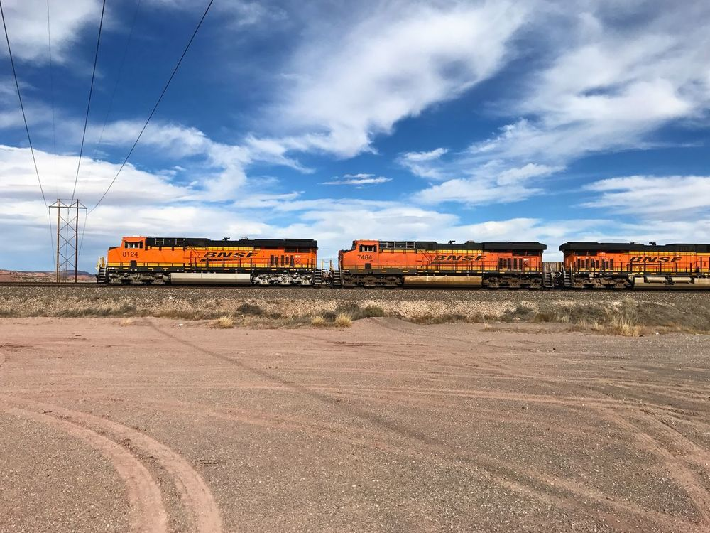 """Three Engine Sky"" A trio of BNSF train engines pulls its load across the Arizona plains framed by blue sky and clouds. Sky Cloud - Sky Transportation Train Trainengine Railroad Railroad Track BNSF Trains Travel Route 66"