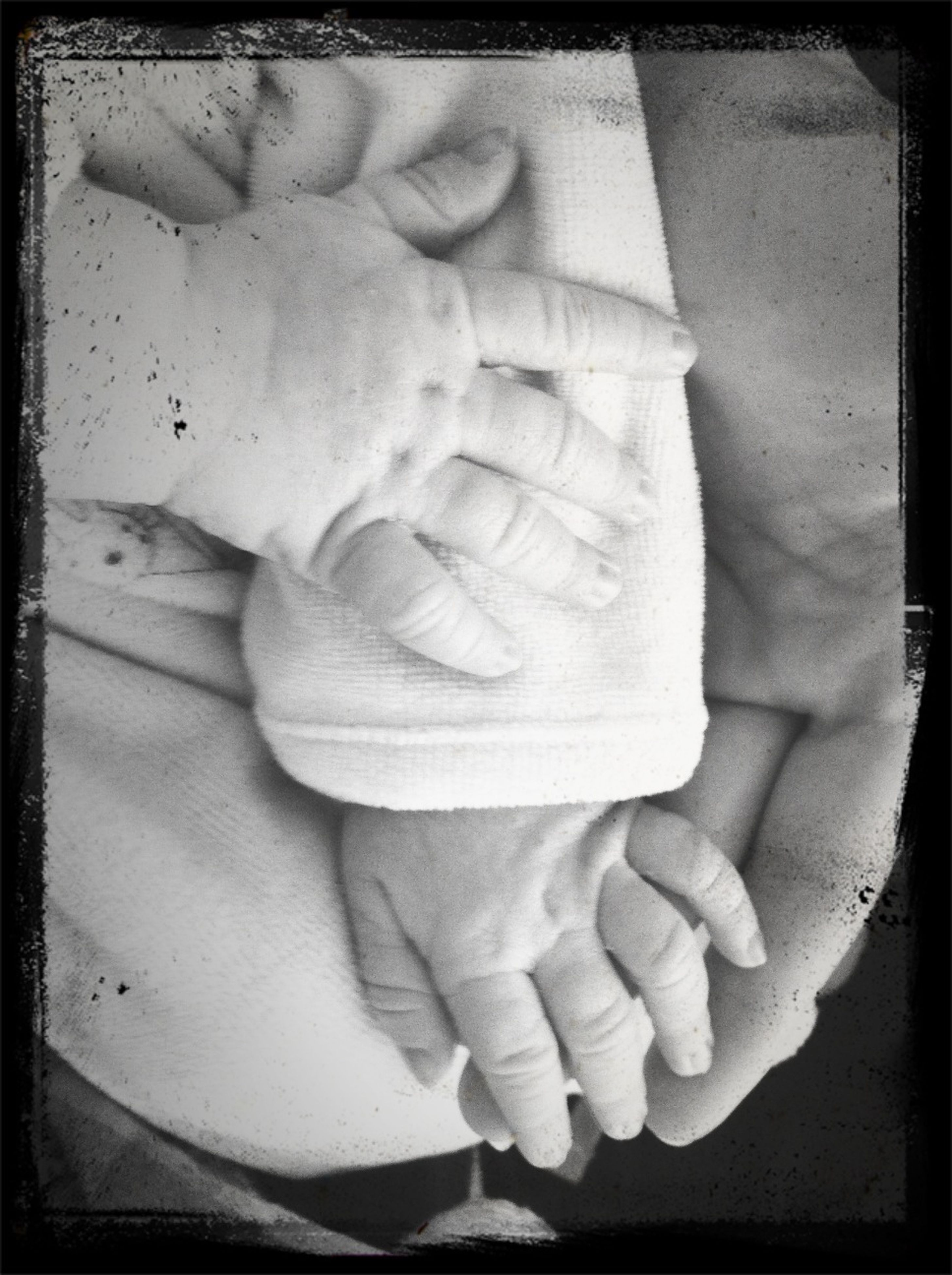 transfer print, person, auto post production filter, indoors, lifestyles, part of, holding, human finger, baby, close-up, leisure activity, unknown gender, men, love, barefoot