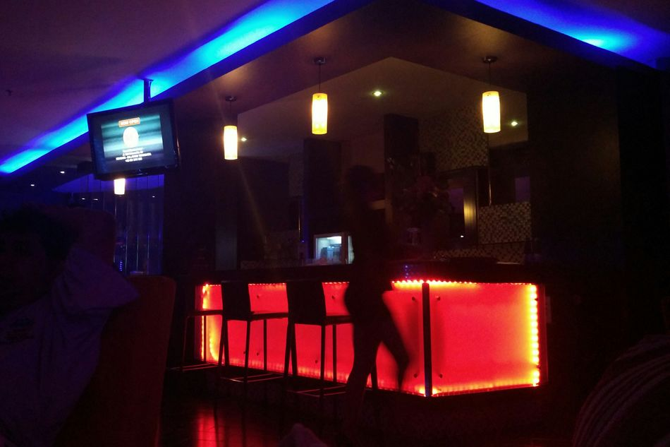 A hostess at a spa. Dramatic Lights Bar Nice Curves Red And Blue