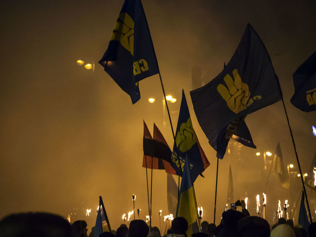 The torchlight procession in honor of the birthday of Stepan Bandera, national hero of Ukraine Bandera Birthday Focus On Foreground HERO Illuminated Multi Colored National Outdoors People And Places Performance Person Procession Sky Stepan Torchlight Ukrain Ukraine