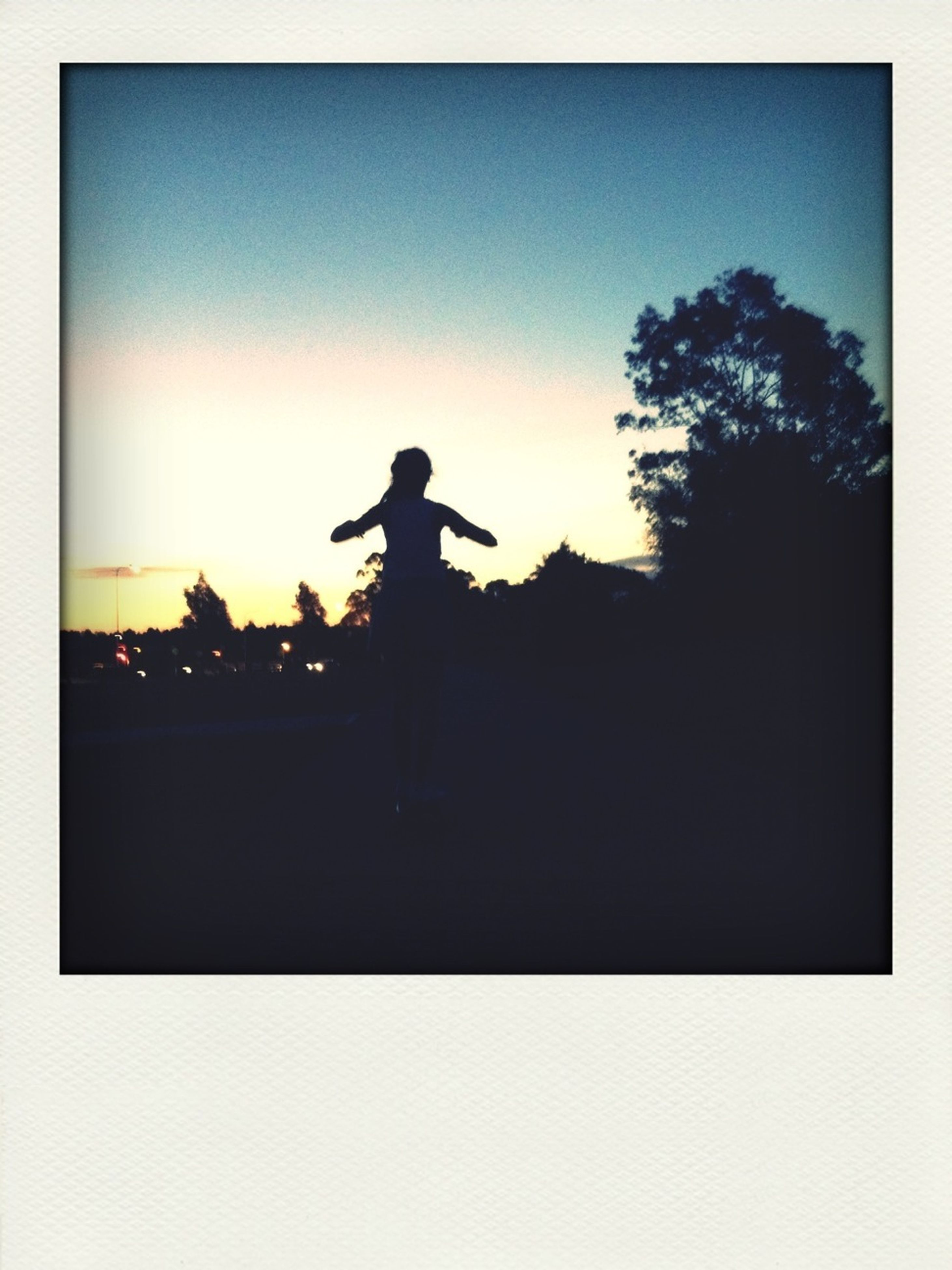 silhouette, copy space, transfer print, sunset, lifestyles, clear sky, leisure activity, men, auto post production filter, outline, sky, standing, dusk, side view, dark, full length, outdoors, one man only