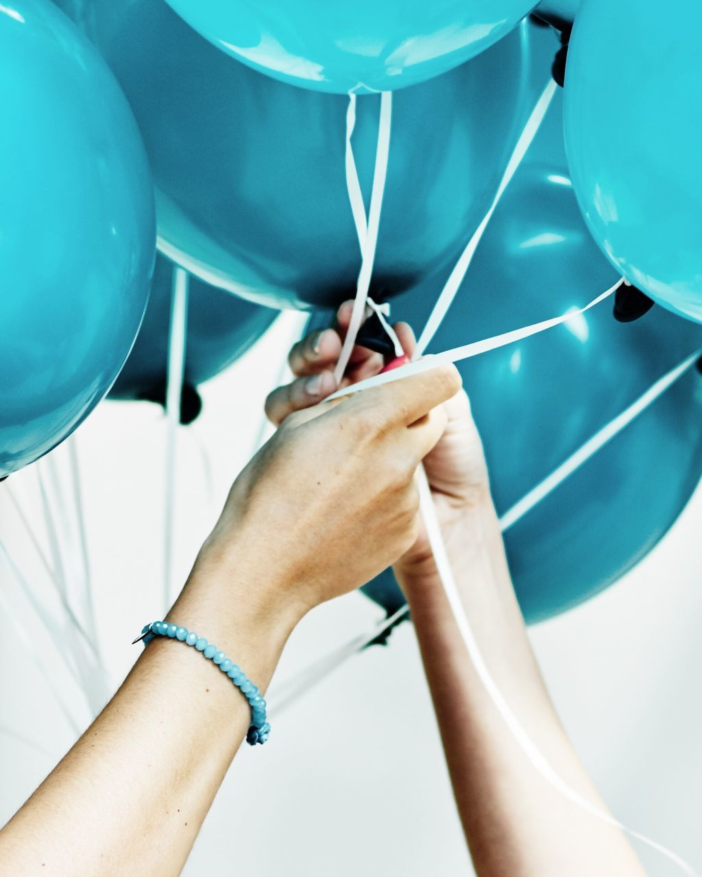 Cropped Image Of Friends Holding Balloons