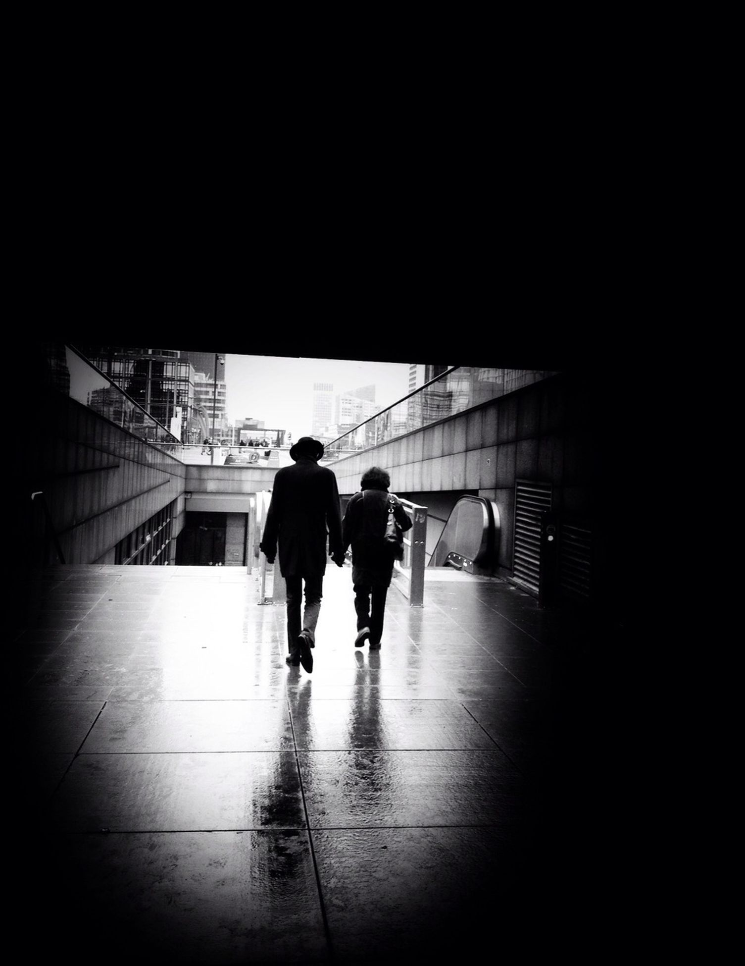 indoors, walking, full length, men, silhouette, rear view, lifestyles, architecture, built structure, person, togetherness, leisure activity, tunnel, city life, standing, on the move, reflection
