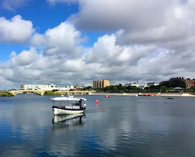 Sky And Clouds Enjoying The Sun Water Water Reflections Lake Boat Tree Bridge Ship Ferry Blue Building Building Exterior