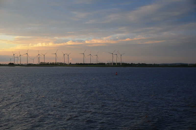 clean energy Alternative Energy Clean Energy Elbe Windpark Environmental Conservation Nature No People Outdoors Renewable Energy Sea Sky Social Issues Sunset Water Wind Power Wind Turbine Windmill Windpark Elbe