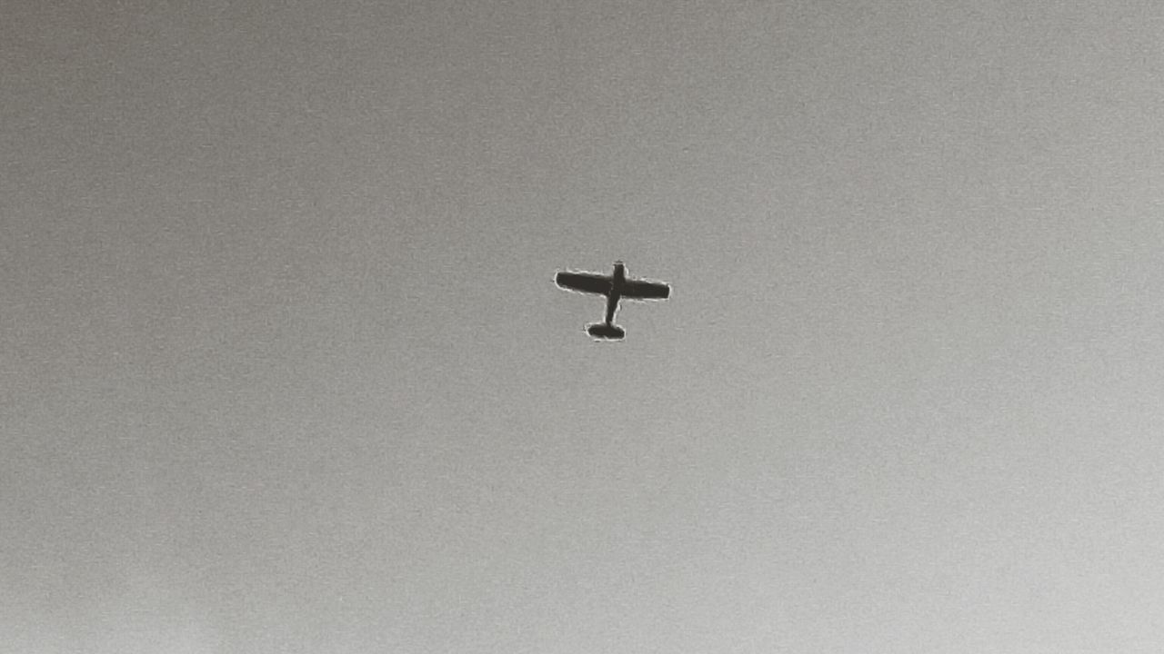 no people, low angle view, airplane, flying, day, outdoors