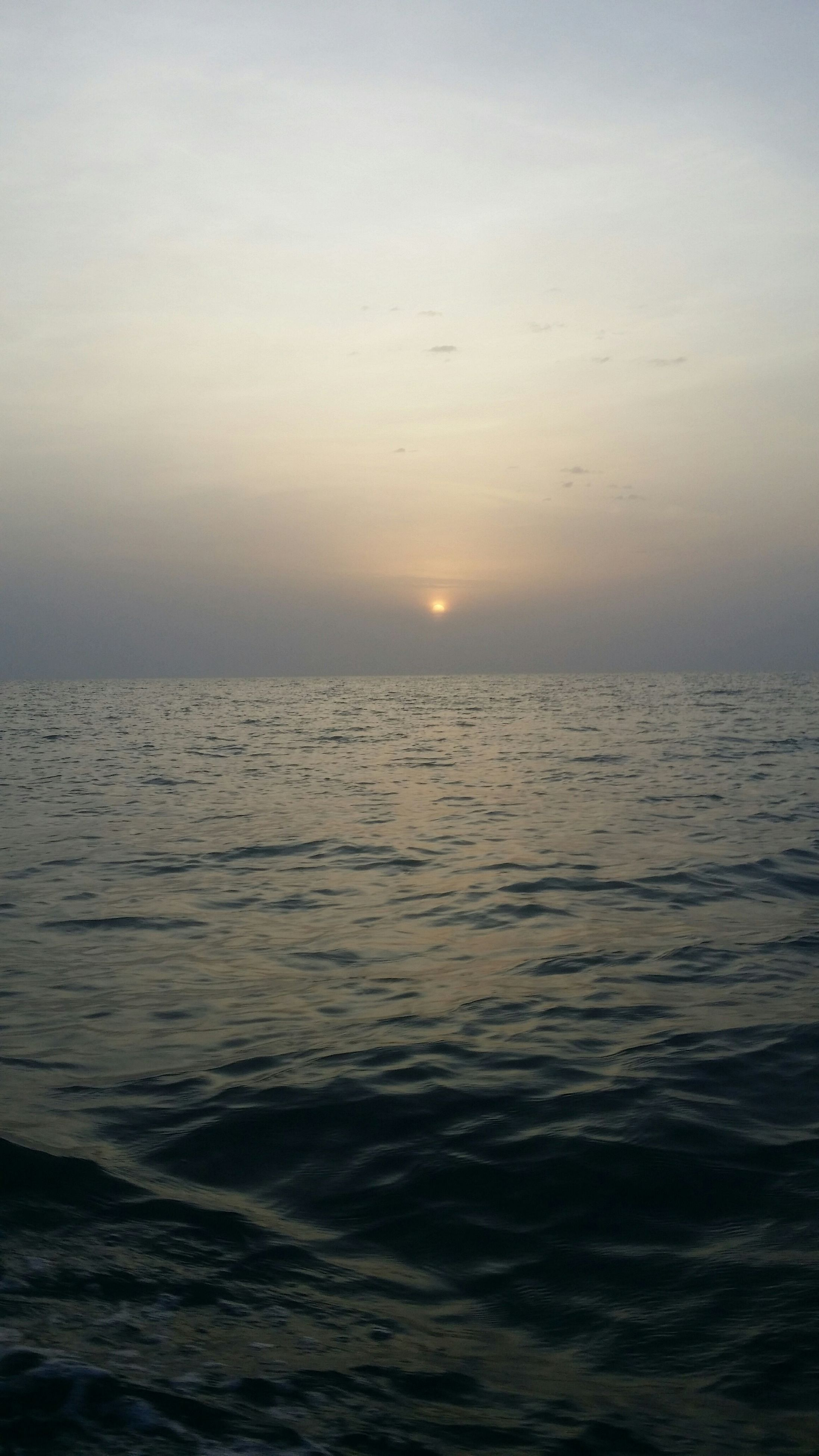 sea, water, horizon over water, scenics, tranquil scene, beauty in nature, waterfront, tranquility, sunset, sky, nature, seascape, idyllic, rippled, wave, sun, outdoors, cloud - sky, remote, no people