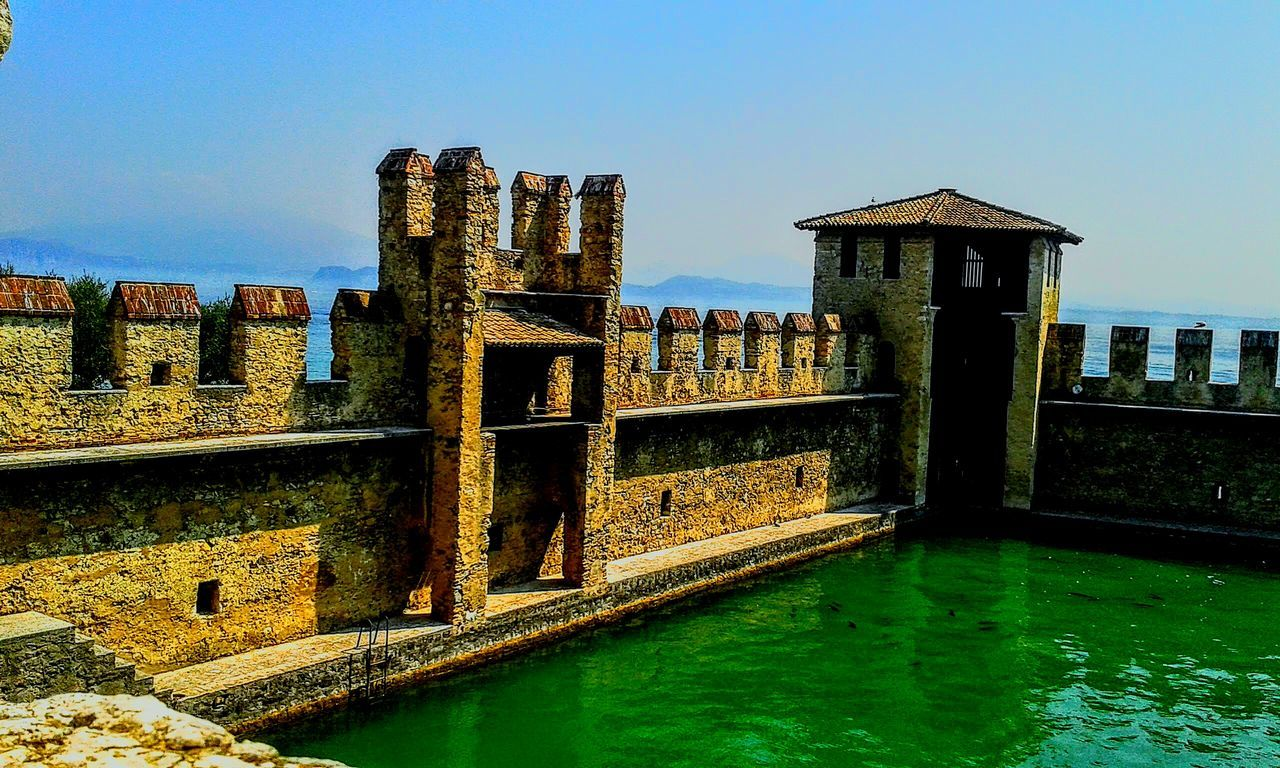 architecture, built structure, history, water, outdoors, no people, day, ancient, building exterior, old ruin, waterfront, sky, nature, clear sky, ancient civilization