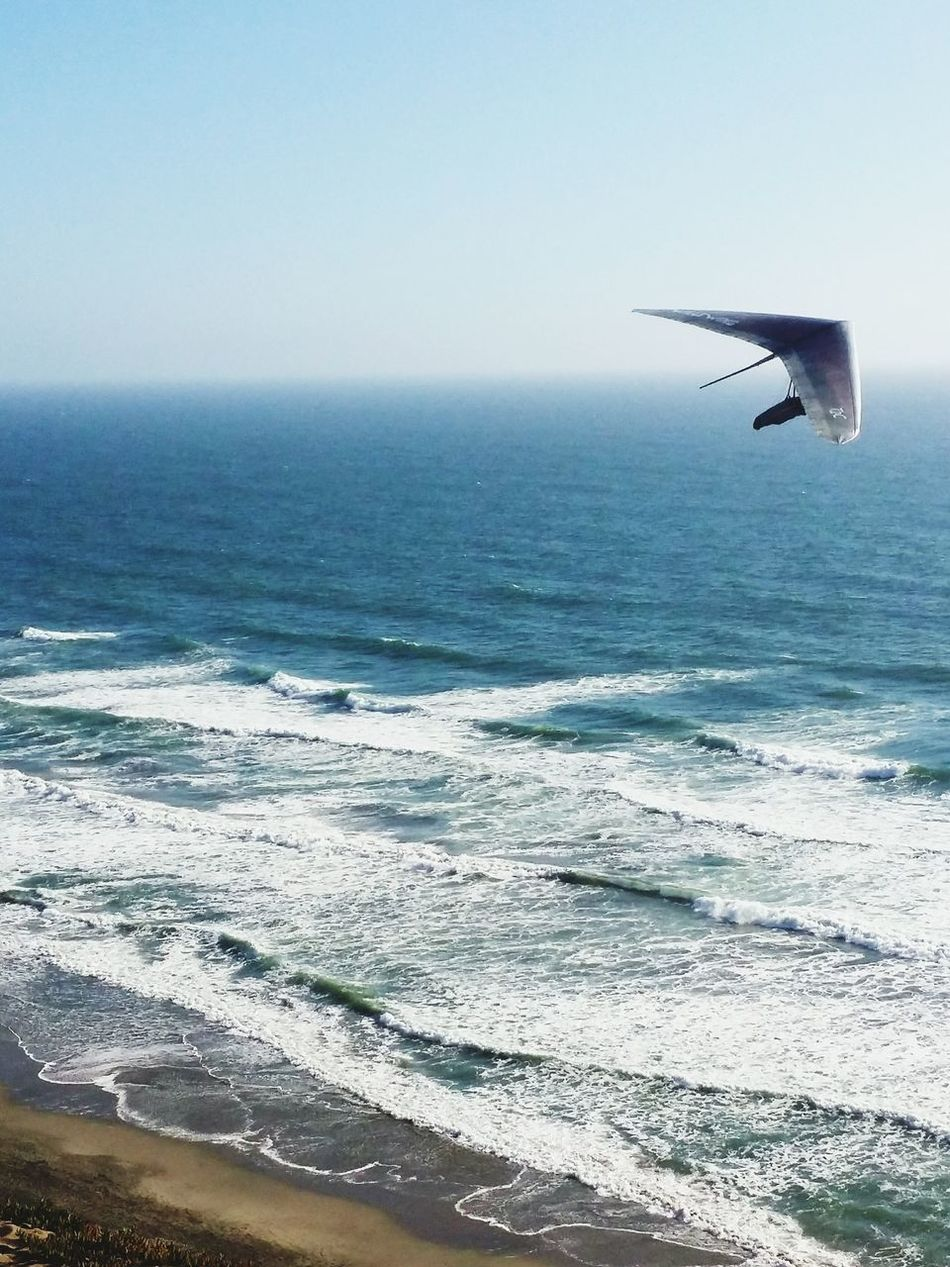 The Color Of Sport Into The Blue Flight Hand Gliding Horizon Over Water