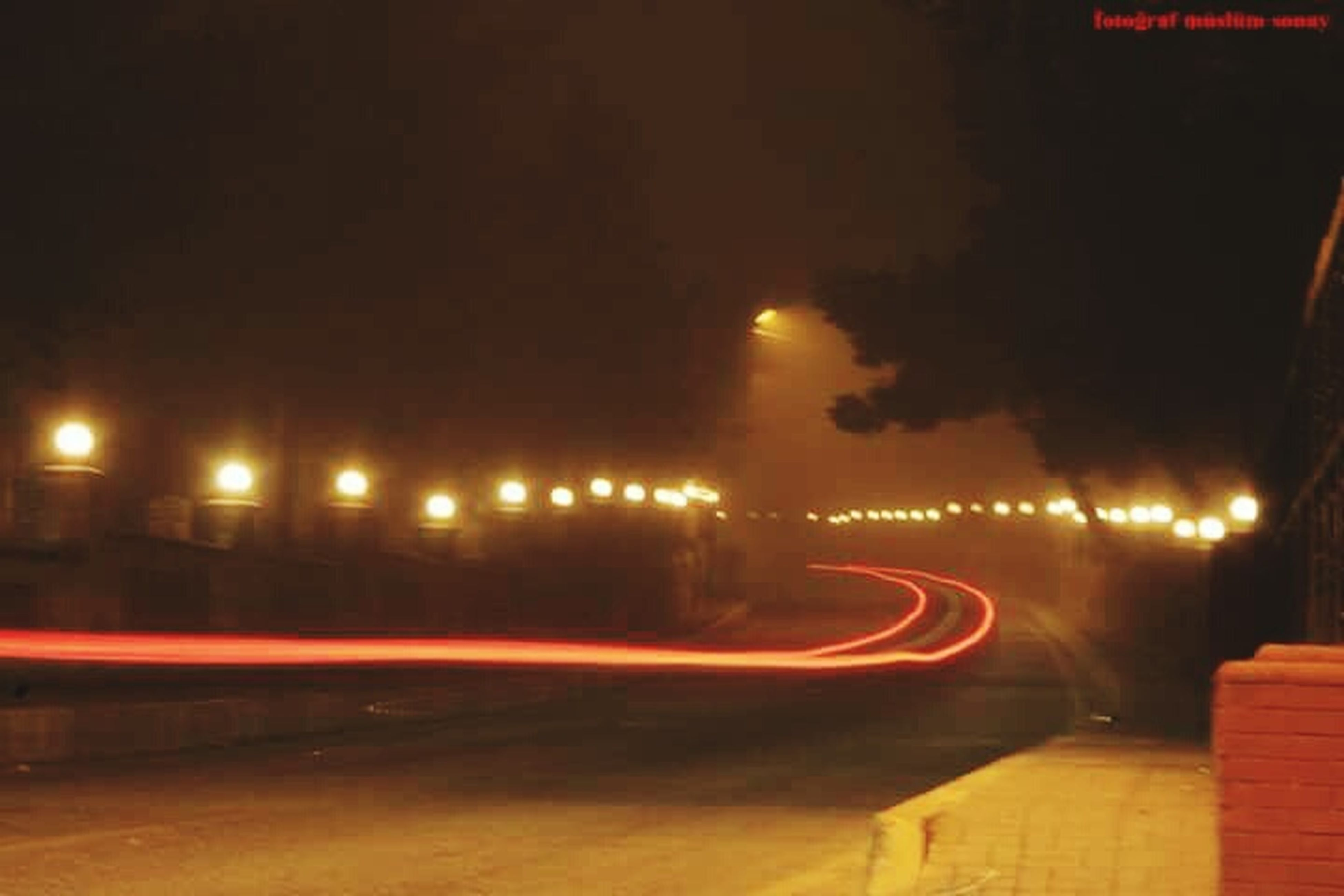 illuminated, night, transportation, long exposure, light trail, street light, speed, motion, lighting equipment, the way forward, road, blurred motion, street, city, sky, building exterior, mode of transport, light - natural phenomenon, on the move, city life