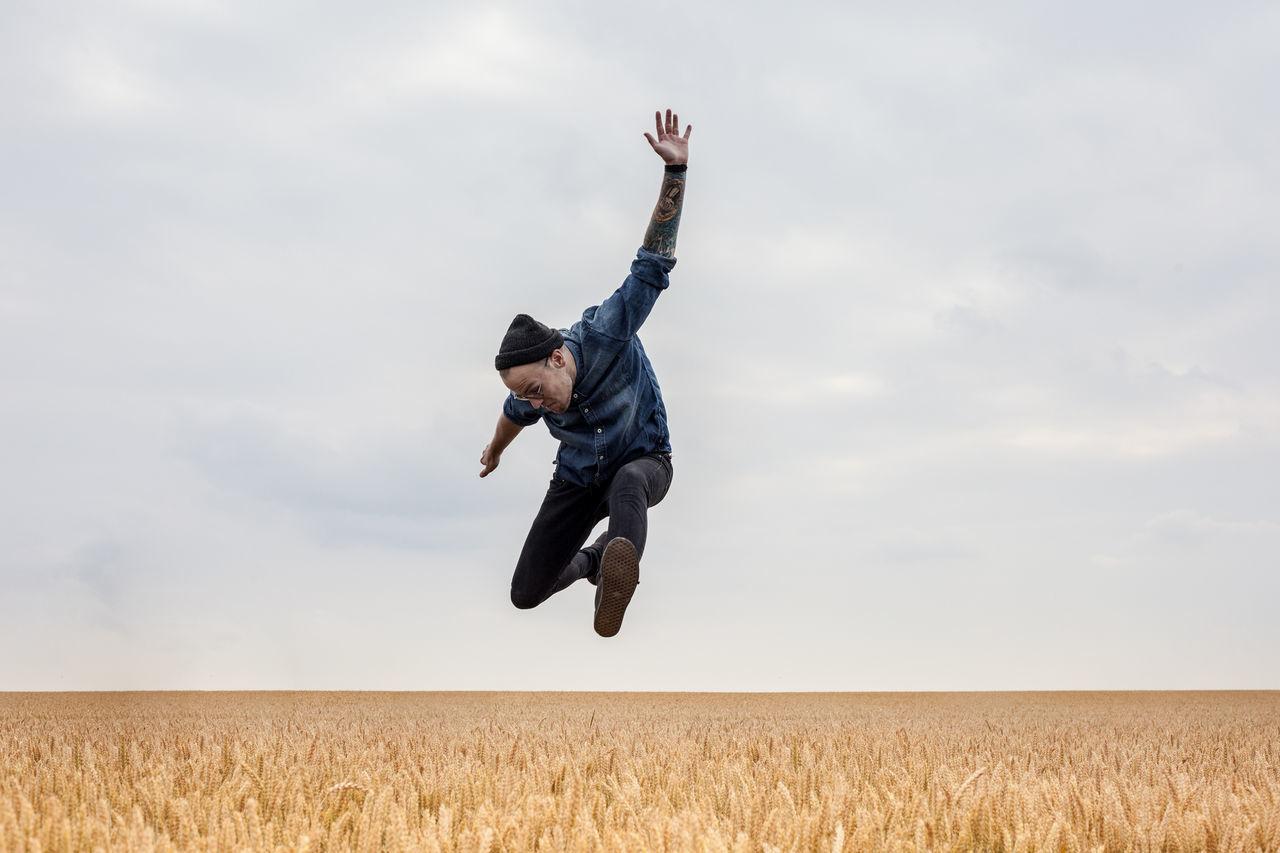 People Jumping Peoplephotography People Of EyeEm Jumping Shot Field Freedom Happiness Happy Happy People Tattoo Tattooed Drummer Fieldscape Fields Of Gold Enjoyment Fan Jumping For Joy Jump Horizontal Horizontal Symmetry Horizon Over Land