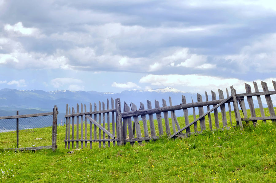 Wooden fences. Dinaric view 🌥 Balkan Behind The Border Cloud - Sky Dinaric Dinaric Region Dinaric View Enclosure Grass Green Color Hedge Hedgerow In A Row In A Row Landscape Limit Protection Safety Village Photography Village View Wooden Enclosure Wooden Fences