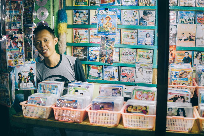 Adult Adults Only Business Finance And Industry Day Market Night One Person People People Photography People Watching Portrait Retail  Smiling Street Photography