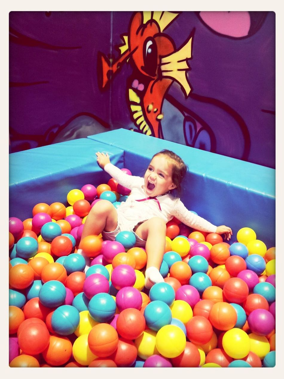 macie in the ball pit