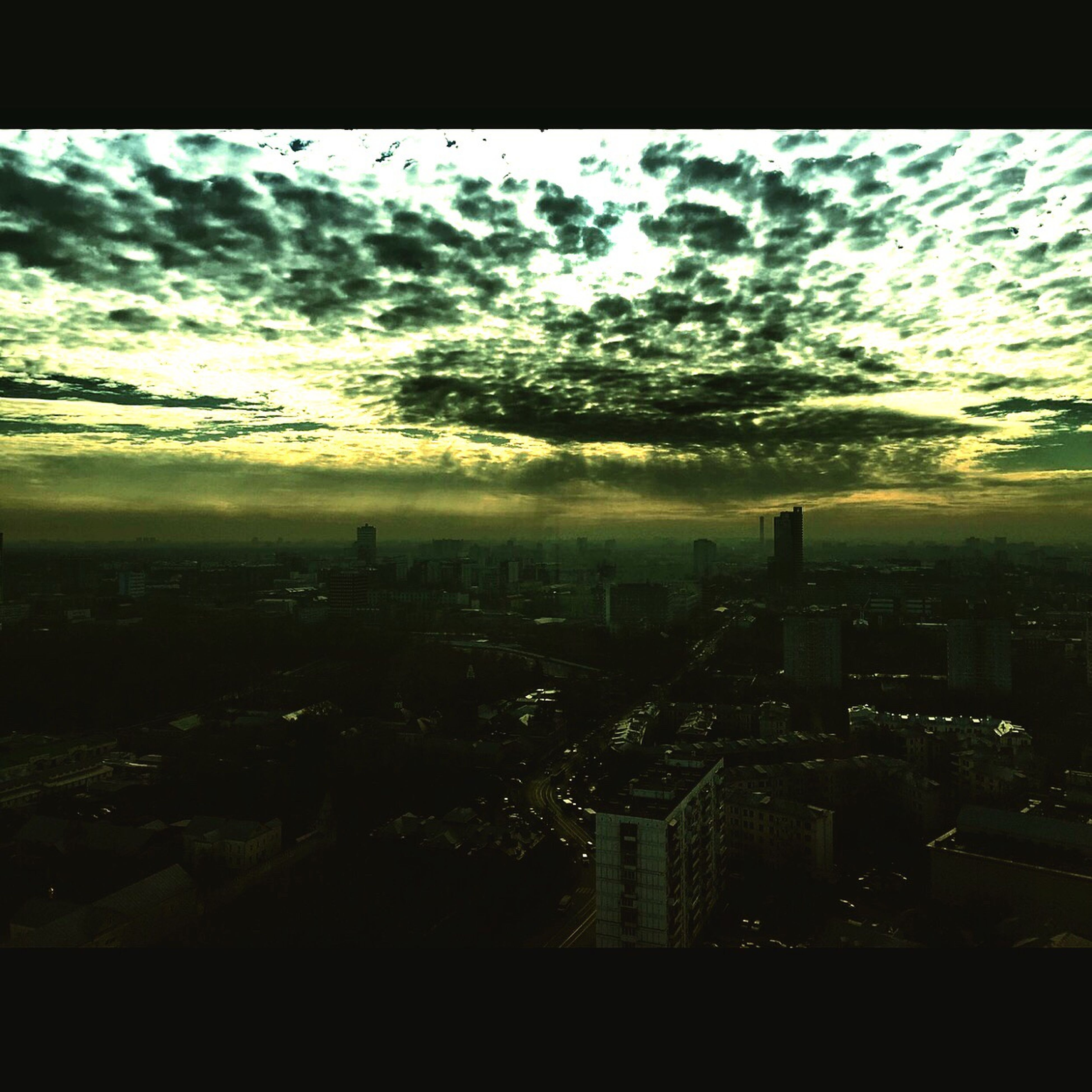 cityscape, city, building exterior, architecture, built structure, sky, skyscraper, crowded, cloud - sky, high angle view, residential district, auto post production filter, residential building, silhouette, dusk, no people, residential structure, tower, transfer print, outdoors