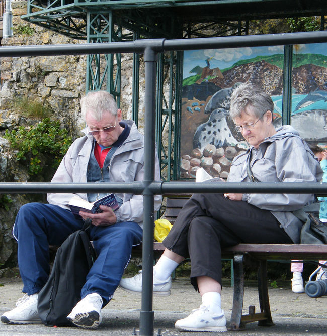 Bench Companionship Friendship Leisure Activity Married Couple Park Bench Reading Relaxation Seafront Seaside Sitting Telling Stories Differently The Human Condition Up Close Street Photography When The Kids Have Gone The Love Of Books Couple