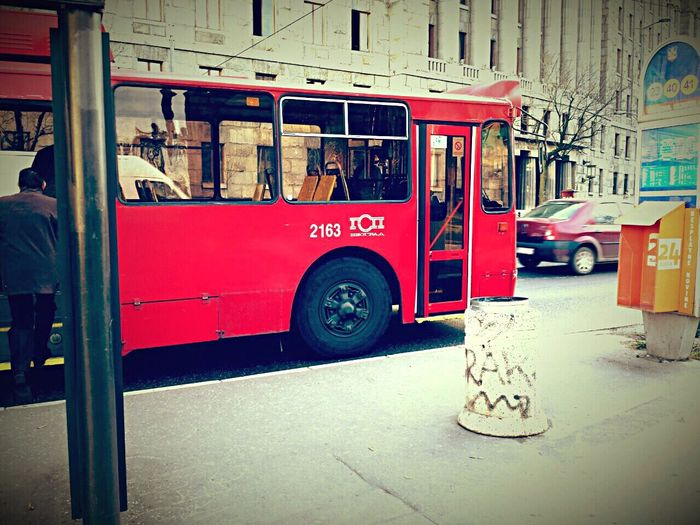 Embrace Urban Life Trolly Bus Red Cars Early Morning Outdoor Photography Warm Light Good Vibes
