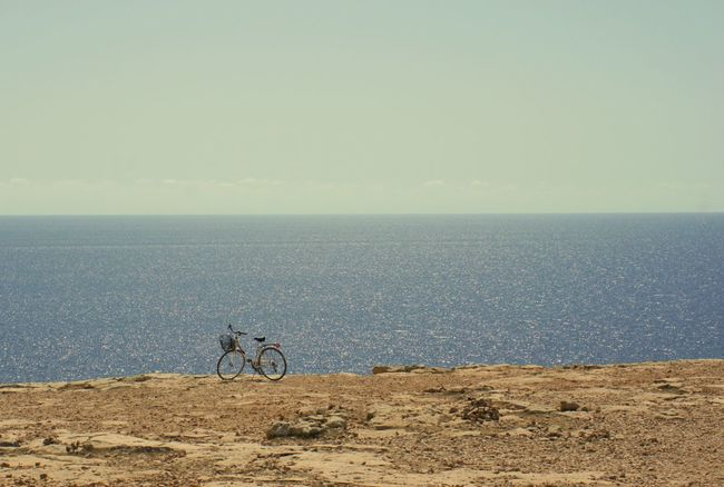 Bicycle on the Cliff Summer Views What Means Summer? Summertime Pastel Power Celebrate Your Ride The Essence Of Summer Blue Wave Sea View in Cap De Barbaria, Formentera, Illes Balears