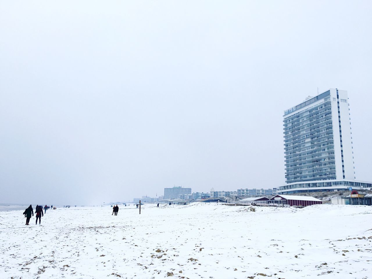 Snow Winter Cold Temperature Building Exterior Weather Built Structure Nature Outdoors Fog Winter Beach Architecture Day Real People City Men Sky Mammal Seaside
